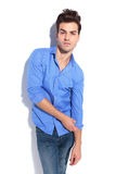 Attractive young fashion man pulling his sleeve. Royalty Free Stock Photo