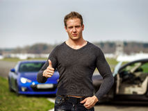 Attractive young fashion man showing the thumbs up gesture Royalty Free Stock Photos
