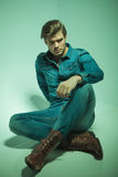Attractive young fashion man sitting on the floor Stock Image