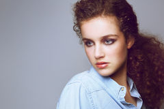 Attractive young fashion model with curly hair Royalty Free Stock Images