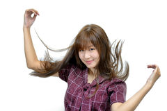 Attractive young fashion model and flicking her hair royalty free stock photos