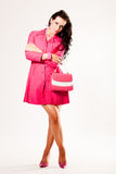 Attractive young fashion model in pink coat. And heels Stock Image