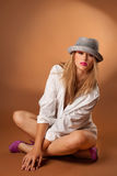 Attractive young fashion model in top hat Royalty Free Stock Photography
