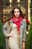 Attractive young fashion woman in coat near the restaurant Stock Images
