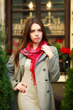 Attractive young fashion woman in coat near the restaurant Royalty Free Stock Photo