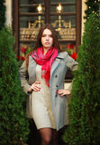 Attractive young fashion woman in coat near the restaurant Stock Image