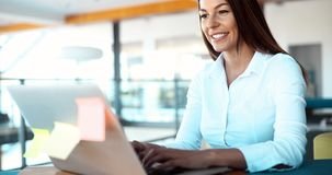 Attractive young female architect working on laptop. In office Stock Photos