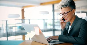 Attractive young female architect working on laptop. In office Royalty Free Stock Image