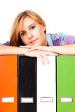 Attractive young female assistant with folders Stock Image