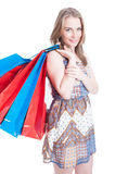 Attractive young female carrying big shopping bags on back Stock Images