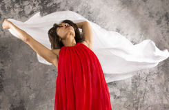 Attractive young female dancer with white fabric and grey backgr Stock Photo