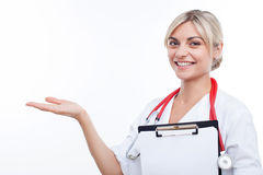 Attractive young female doctor is inviting the Royalty Free Stock Photo