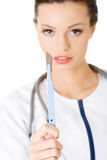 Attractive young female doctor with scalpel. Stock Photos