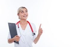 Attractive young female doctor is working with Stock Photography