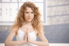 Attractive young female doing yoga exercise Royalty Free Stock Image