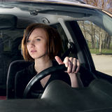 Attractive young female driving car Royalty Free Stock Images