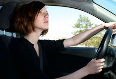 Attractive young female driving car royalty free stock photography
