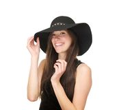 Attractive young female fashion model smiling with black hat Royalty Free Stock Photos