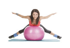 Attractive young female with fitness ball Stock Photography