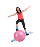 Attractive young female with fitness ball in sport center Royalty Free Stock Images