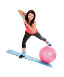 Attractive young female with fitness ball in sport center Stock Image