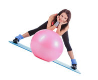 Attractive young female with fitness ball in sport center Royalty Free Stock Photo