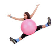 Attractive young female with fitness ball in sport center Stock Photo
