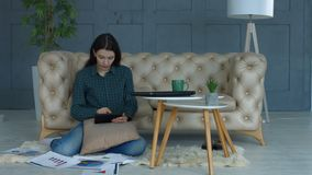 Creative woman with tablet pc working from home stock footage