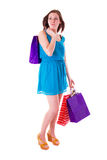 Attractive young female holding shopping bags Royalty Free Stock Images