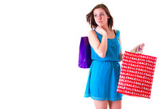 Attractive young female holding shopping bags Royalty Free Stock Image