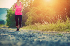 Attractive young female jogging Stock Images