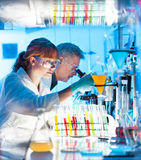 Health care professionals working in laboratory. Stock Photos