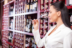 Attractive young female sommelier is tasting red Stock Photography