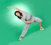 Attractive young female in stretching Royalty Free Stock Photos