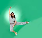 Attractive young female in stretching over green Royalty Free Stock Photo