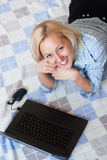 Attractive young female using a laptop Royalty Free Stock Images