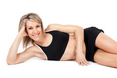 Attractive young fit woman lying on the floor Royalty Free Stock Photos