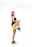 Attractive young fitness woman in black singlet. Studio shot. Stock Image