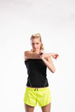 Attractive young fitness woman in black tank top. Studio shot. Royalty Free Stock Photography