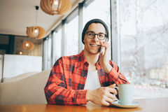 Attractive young freelancer is sitting in cafe Royalty Free Stock Photo