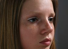 Attractive young girl. Portrait of attractive young girl with long hair and freckles Stock Image