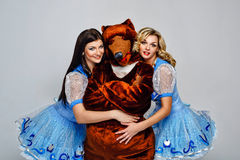 Attractive young girl and bear. Attractive young girl hugging bear puppets Royalty Free Stock Photo