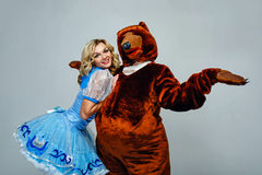 Attractive young girl and bear Royalty Free Stock Photo