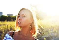 Attractive young girl in beautiful sunshine Stock Image