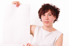 Attractive young girl with a big piece of paper Royalty Free Stock Photos