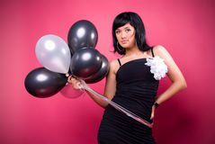 Attractive young girl with birthday balloons Royalty Free Stock Image