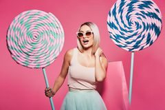 Beautiful model with sweets at pink background royalty free stock image