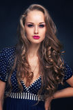 Attractive young girl in blue dress Royalty Free Stock Photography