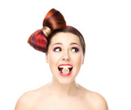 Attractive young girl with a bow haircut eating jelly Royalty Free Stock Images