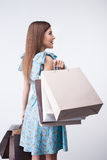 Attractive young girl is buying everything with Royalty Free Stock Image